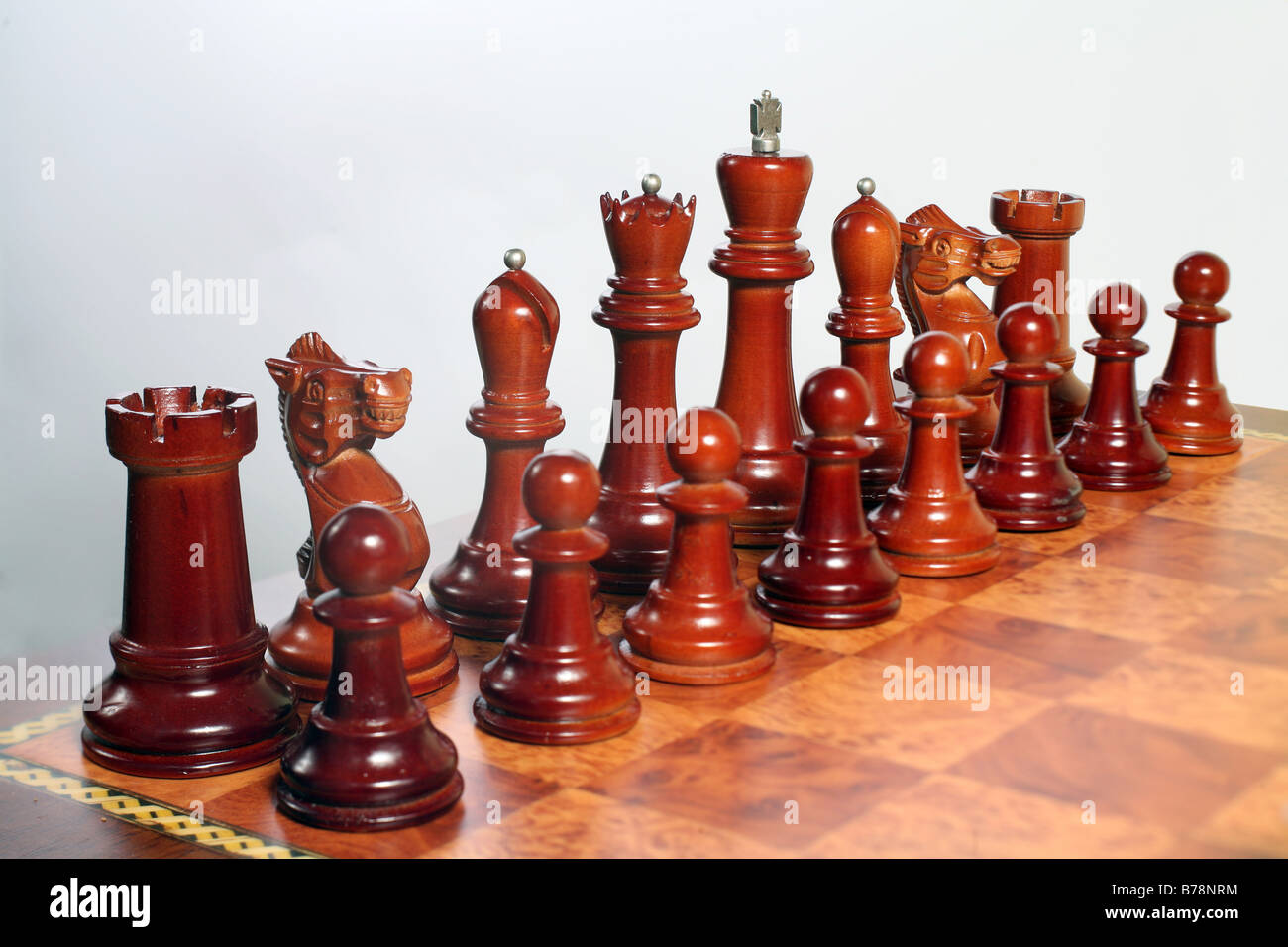 The black pieces set up on a chessboard. - Stock Image