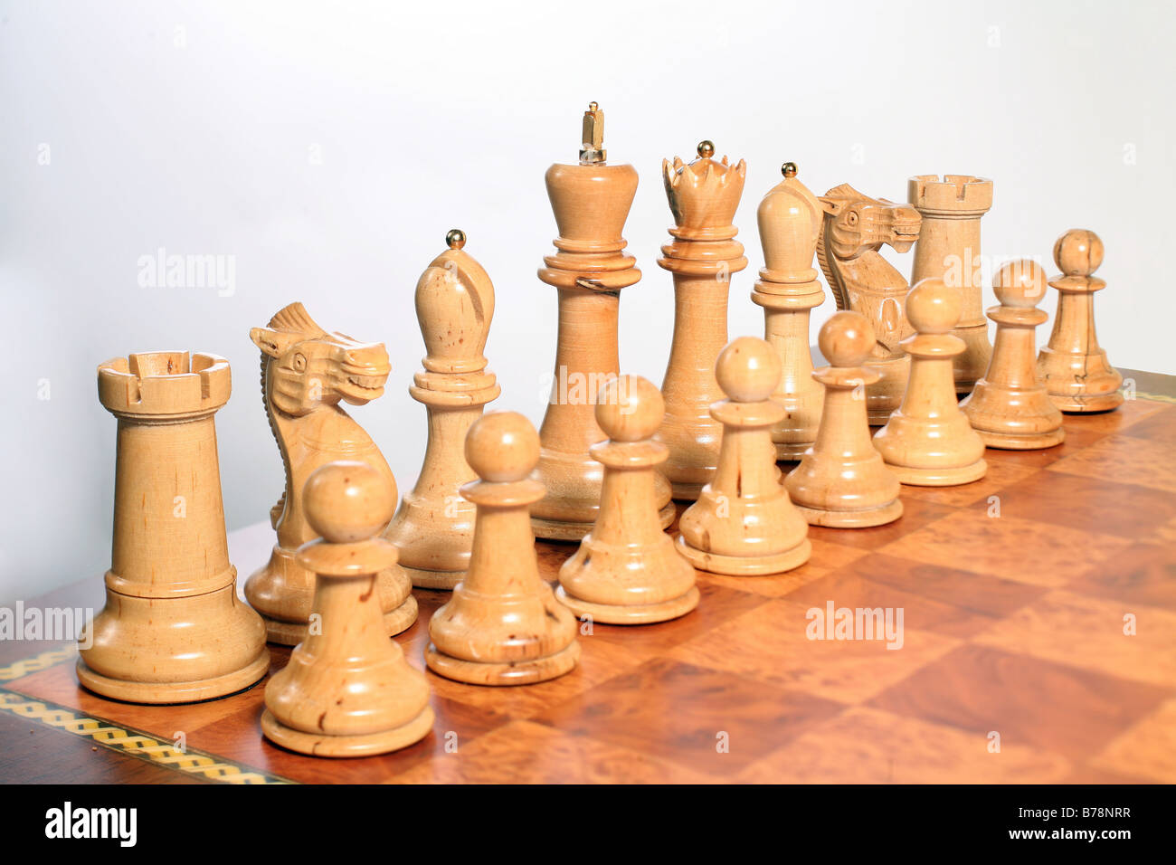 The white pieces set up on a chessboard. - Stock Image