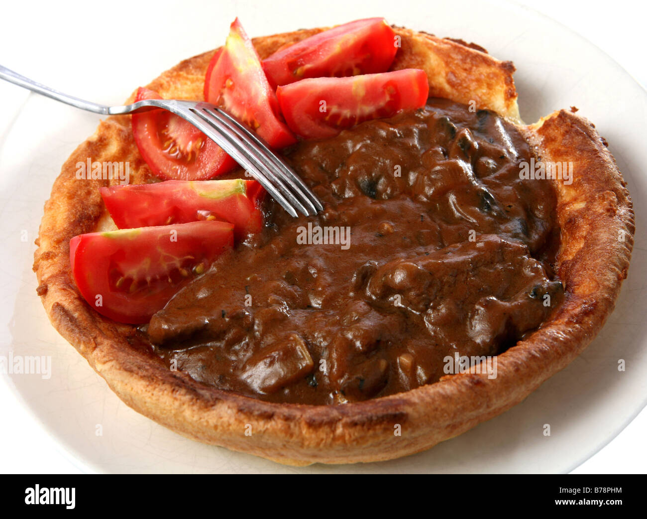 A Big Yorkshire Pudding Filled With Stewed Beef And Mushrooms In