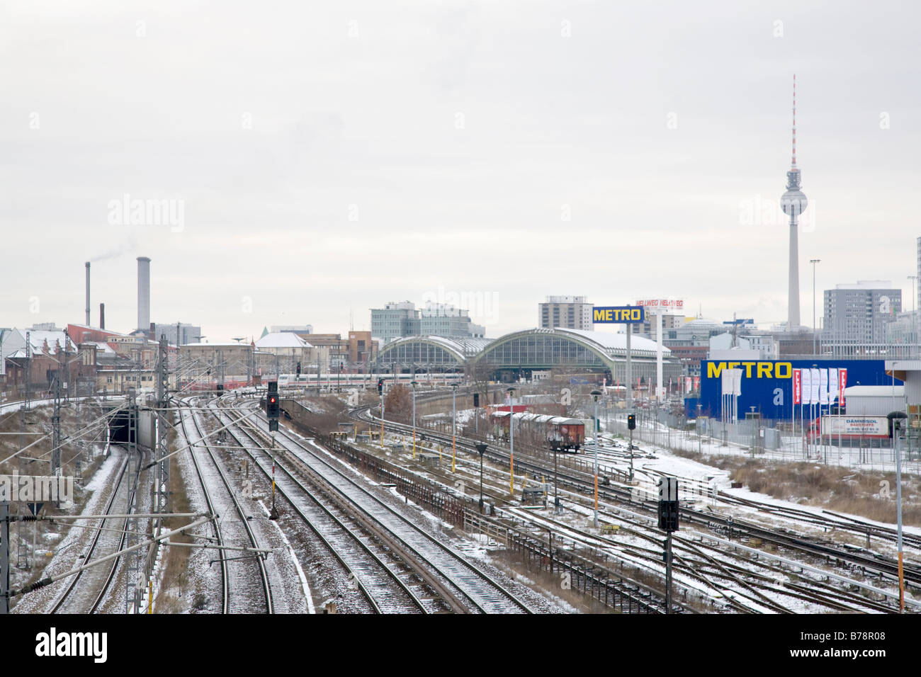Berlin skyline with traintracks and snow. - Stock Image