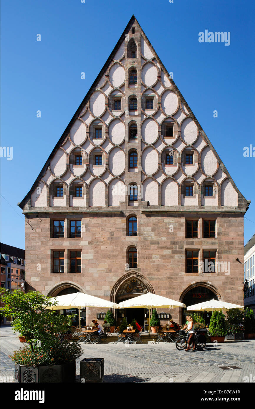 Granary on Hallplatz Square, former salt and grain storage, today Barfuesser brewery with restaurant and several - Stock Image