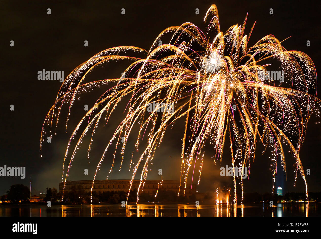 Fireworks at autumn folk festival above Grosser Dutzendteich in front of congress hall, Nazi party rally grounds, - Stock Image