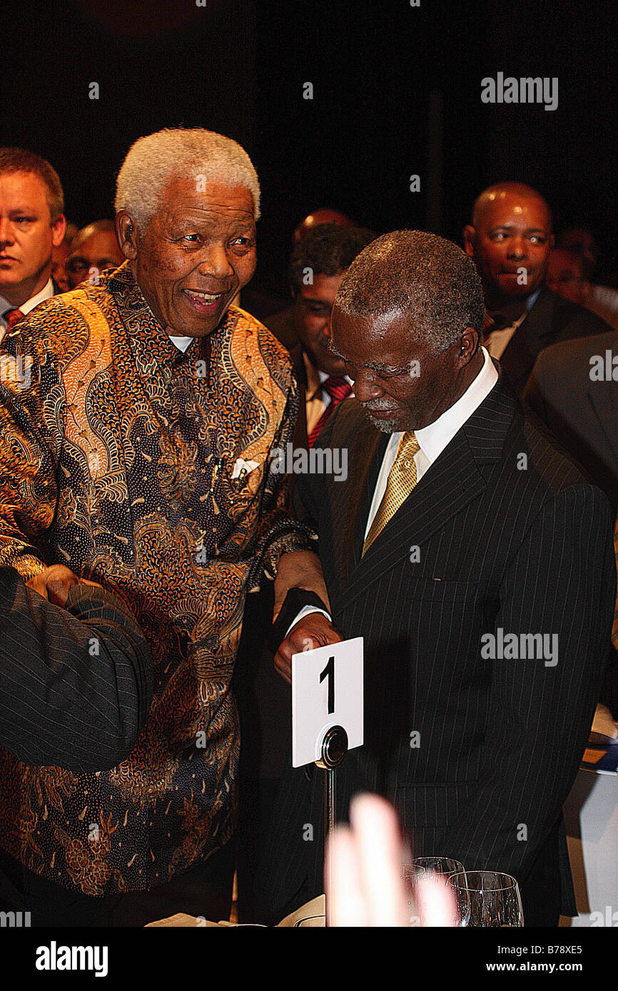 A smiling Nelson Mandela steadied by Thabo Mbeki at a function in Johannesburg - Stock Image