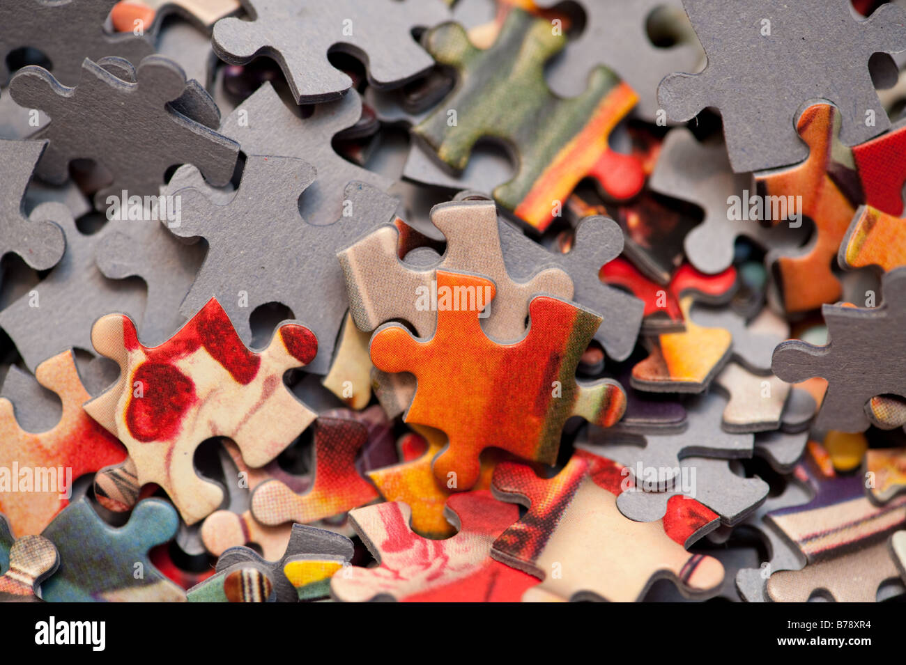 A jumble of jigsaw piece pieces - Stock Image