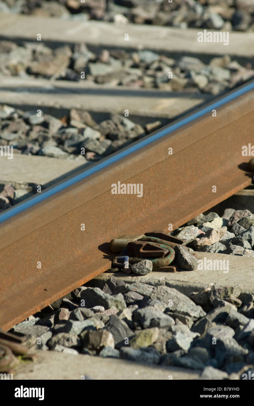 Close up of rail track and clip fastening in the uk - Stock Image