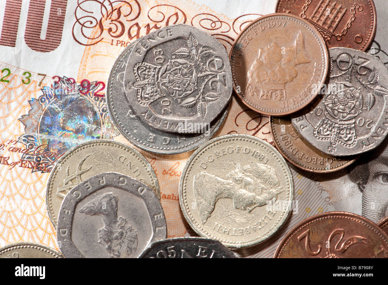 British £10 note and coins - UK sterling currency cash - Stock Image