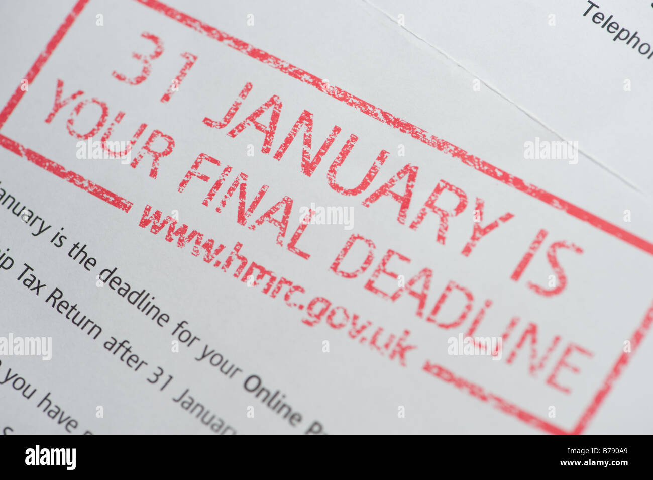 UK Inland Revenue reminder to pay Income Tax by the January 31st final deadline issued by HMRC - Stock Image