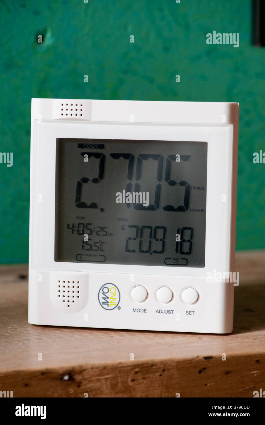 A digital wireless display device for monitoring domestic electricity usage consumption at home UK - Stock Image