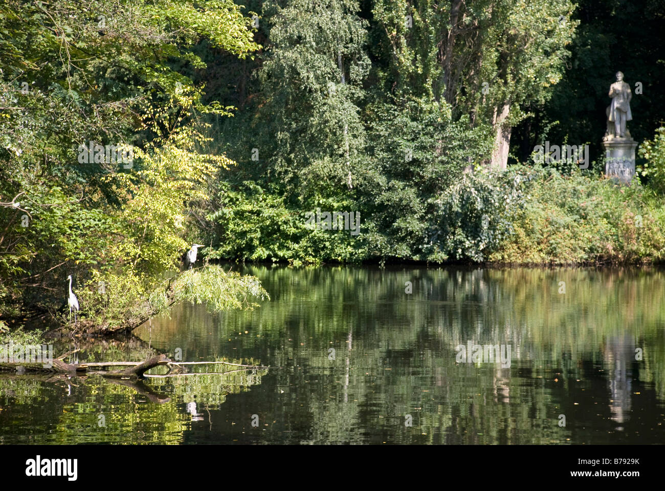 Germany, Berlin, Tiergarten, Lake, sculpture in the background - Stock Image