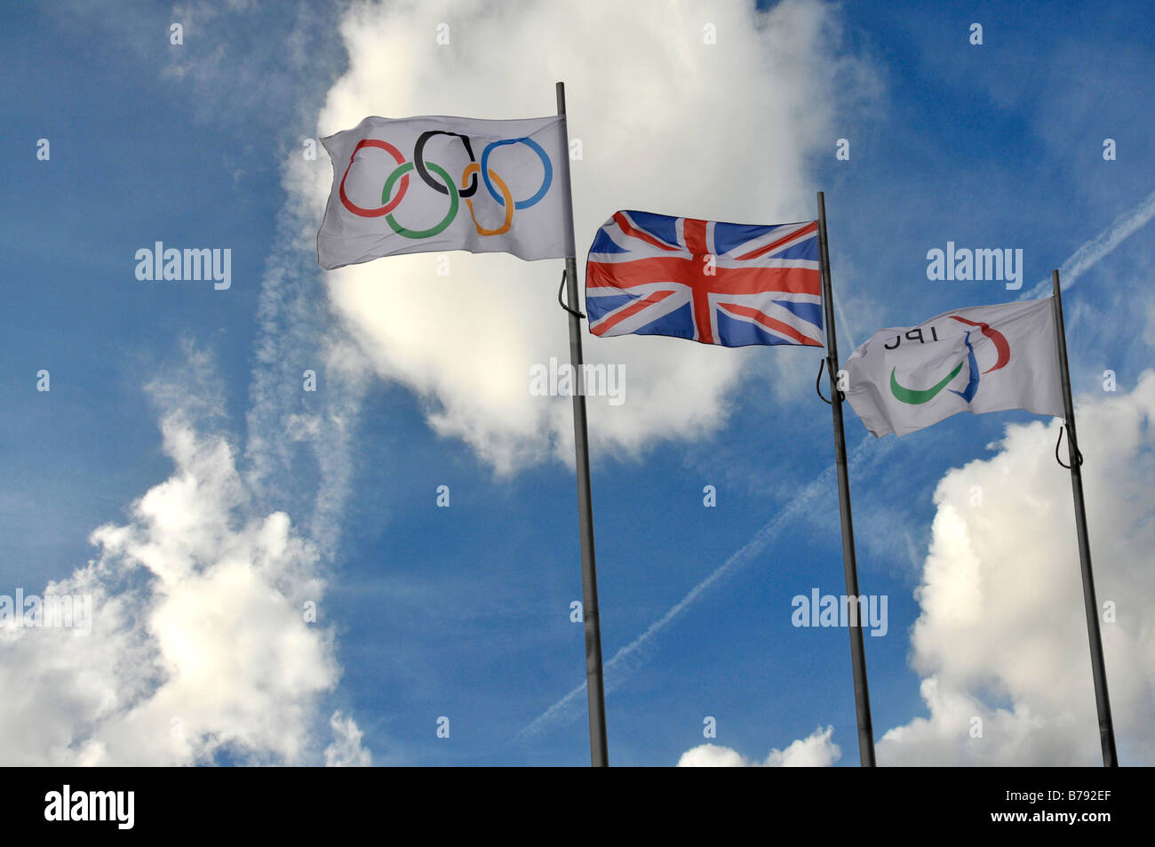 The Olympic flag takes its place beside the Union Jack in front of the Tower Bridge outside London City Hall. - Stock Image