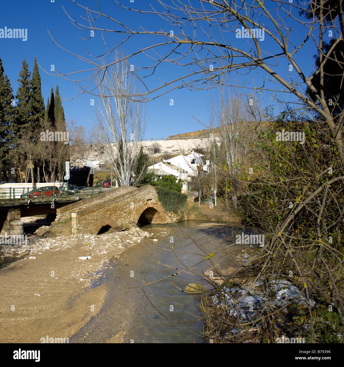 Old sixteenth century footbridge bridge over the river Rio Frio, Riofrio, Andalucia, Spain - Stock Image