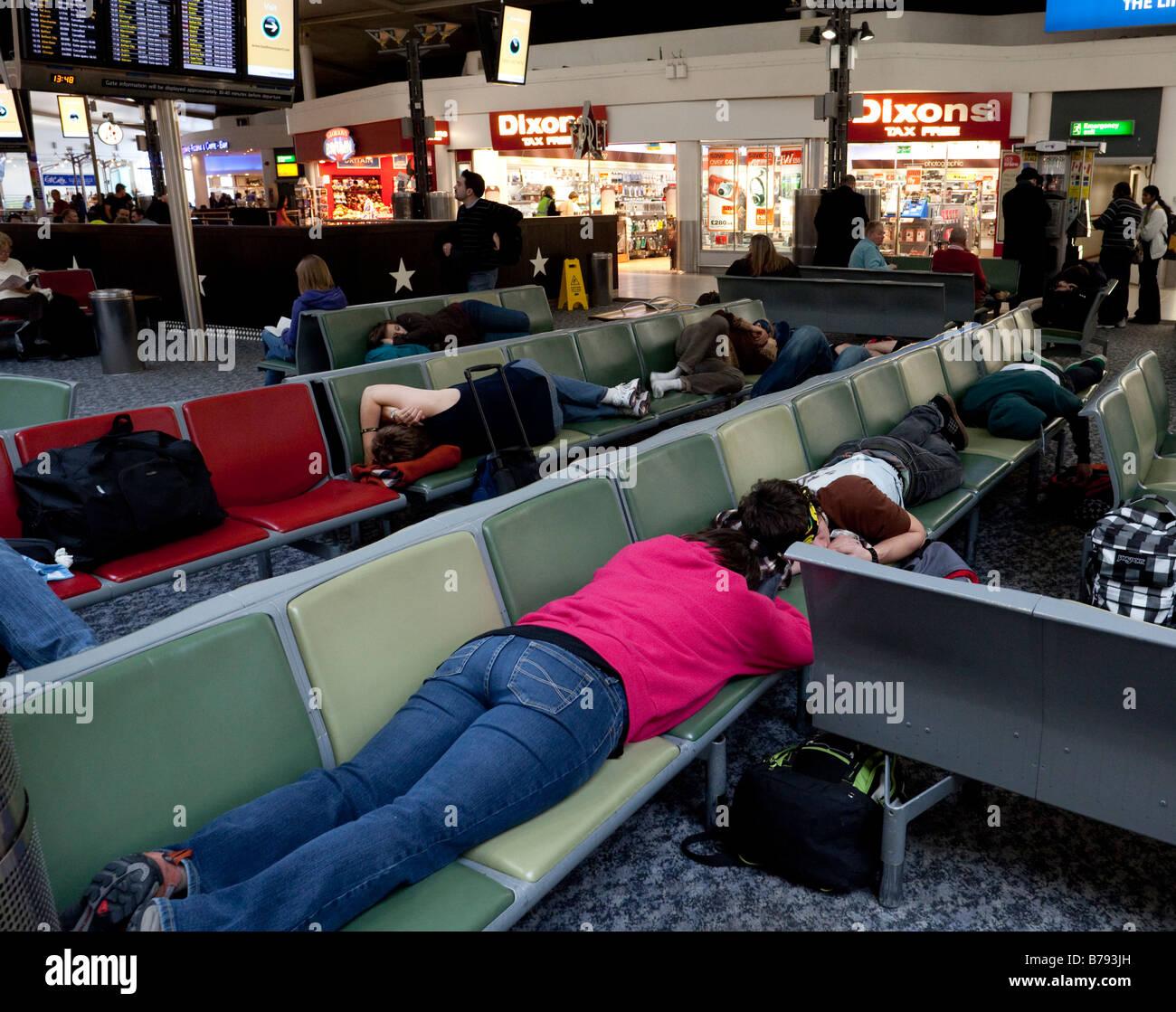 passengers waiting to board flights, Terminal 1 departure lounge, Heathrow, London, England - Stock Image