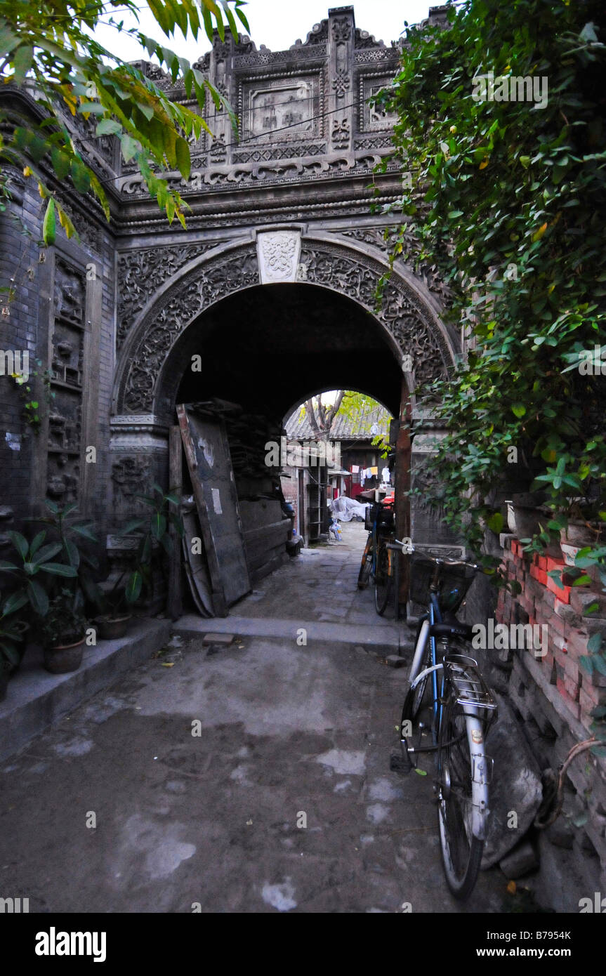 Old arch of a Hutong In Beijing China - Stock Image