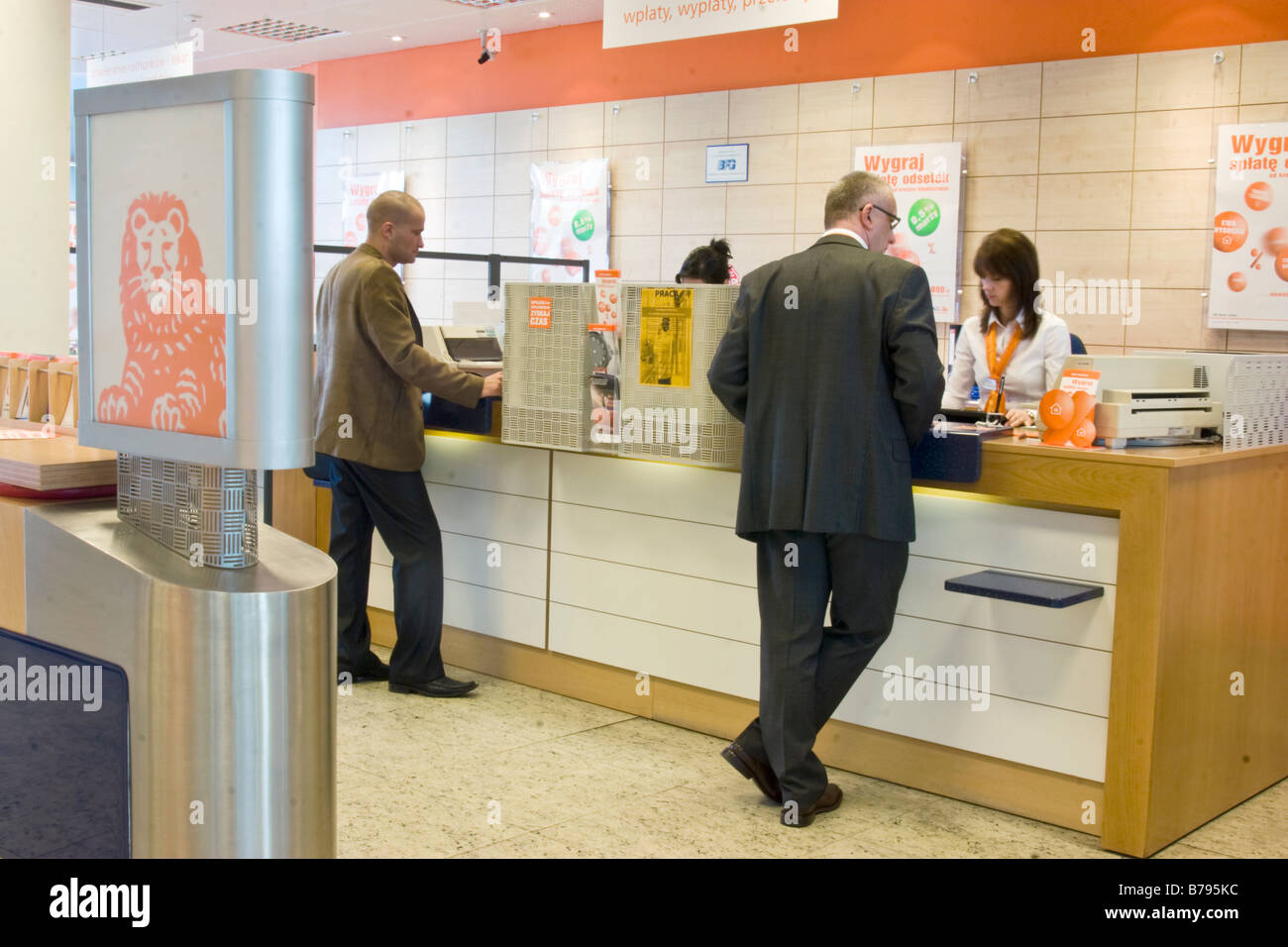 https://c8.alamy.com/comp/B795KC/costumers-inside-ing-bank-poland-B795KC.jpg