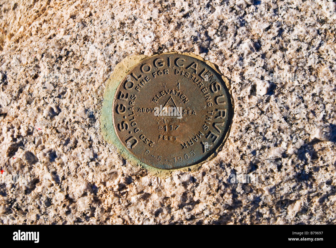 USGS survey marker on the summit of Sentinel Dome Yosemite National Park California - Stock Image