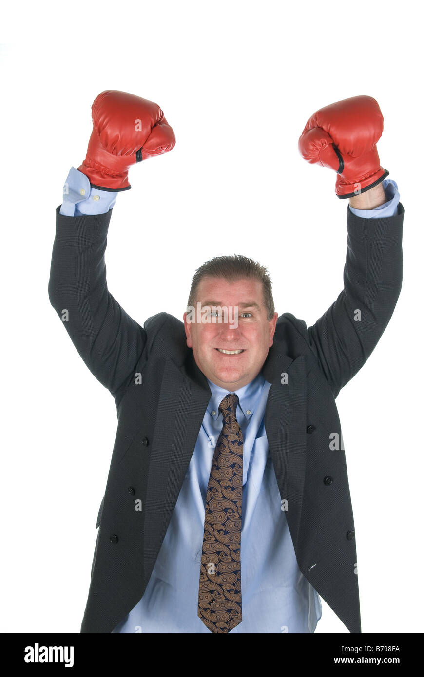 A businessman raised his arms in victory during contract negotiations - Stock Image