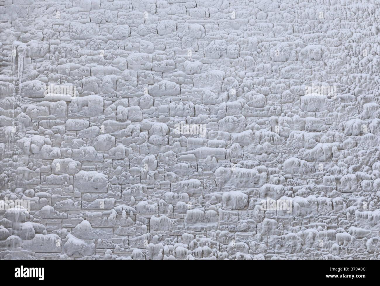 Frozen stone wall - Stock Image