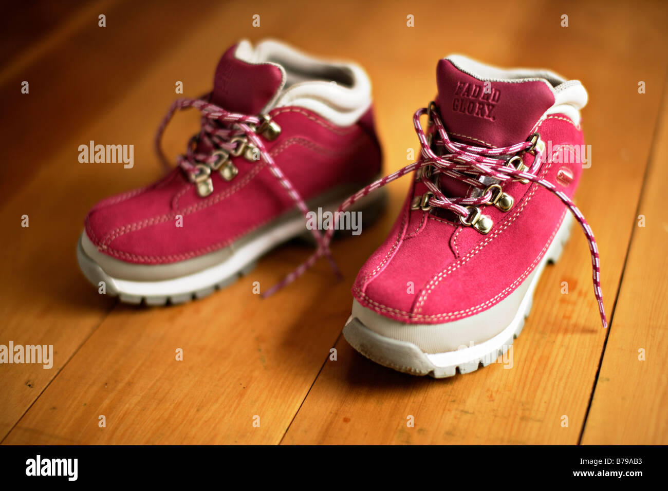 Girl's pink boots to fit a five year old - Stock Image