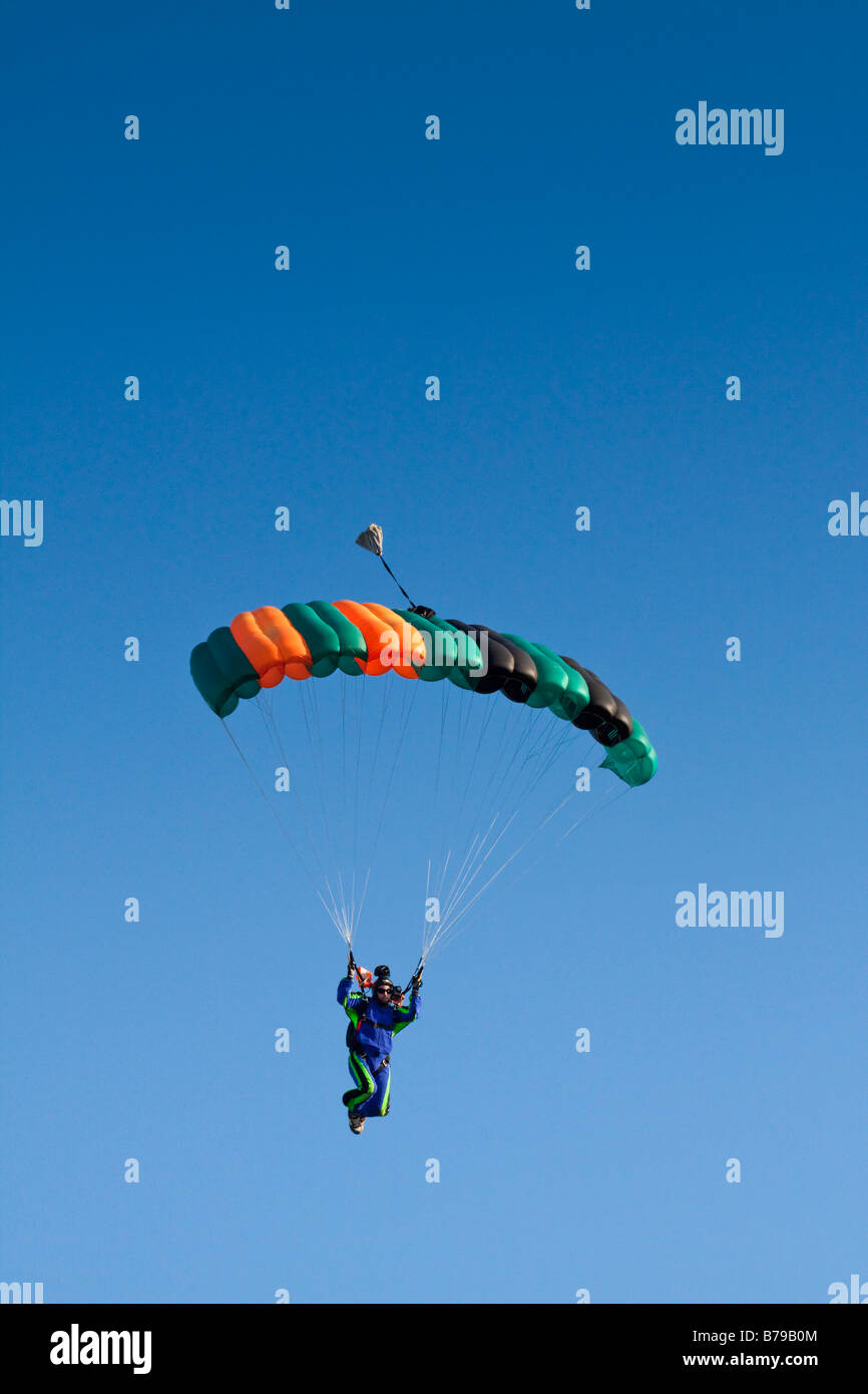 SKYDIVING CAMERA MAN UNDER CANOPY AGAINST A BLUE SKY - Stock Image