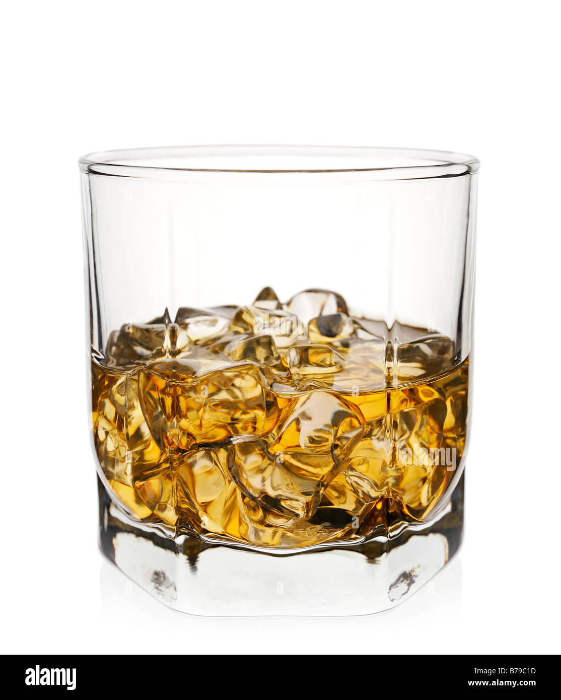 Glass of Whisky with Ice Against a White Background Close Up - Stock Image