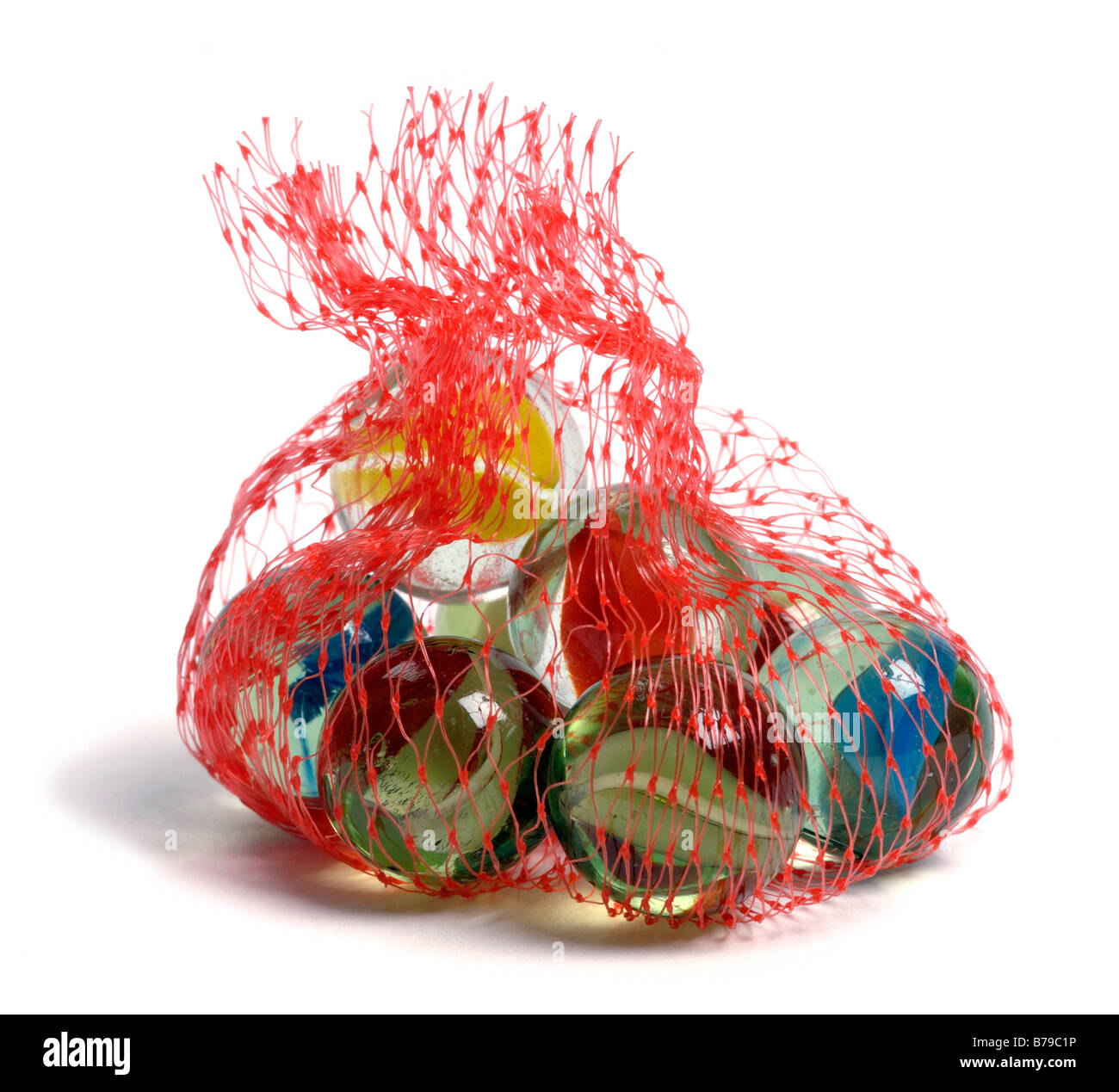 Small bag of glass marbles - Stock Image