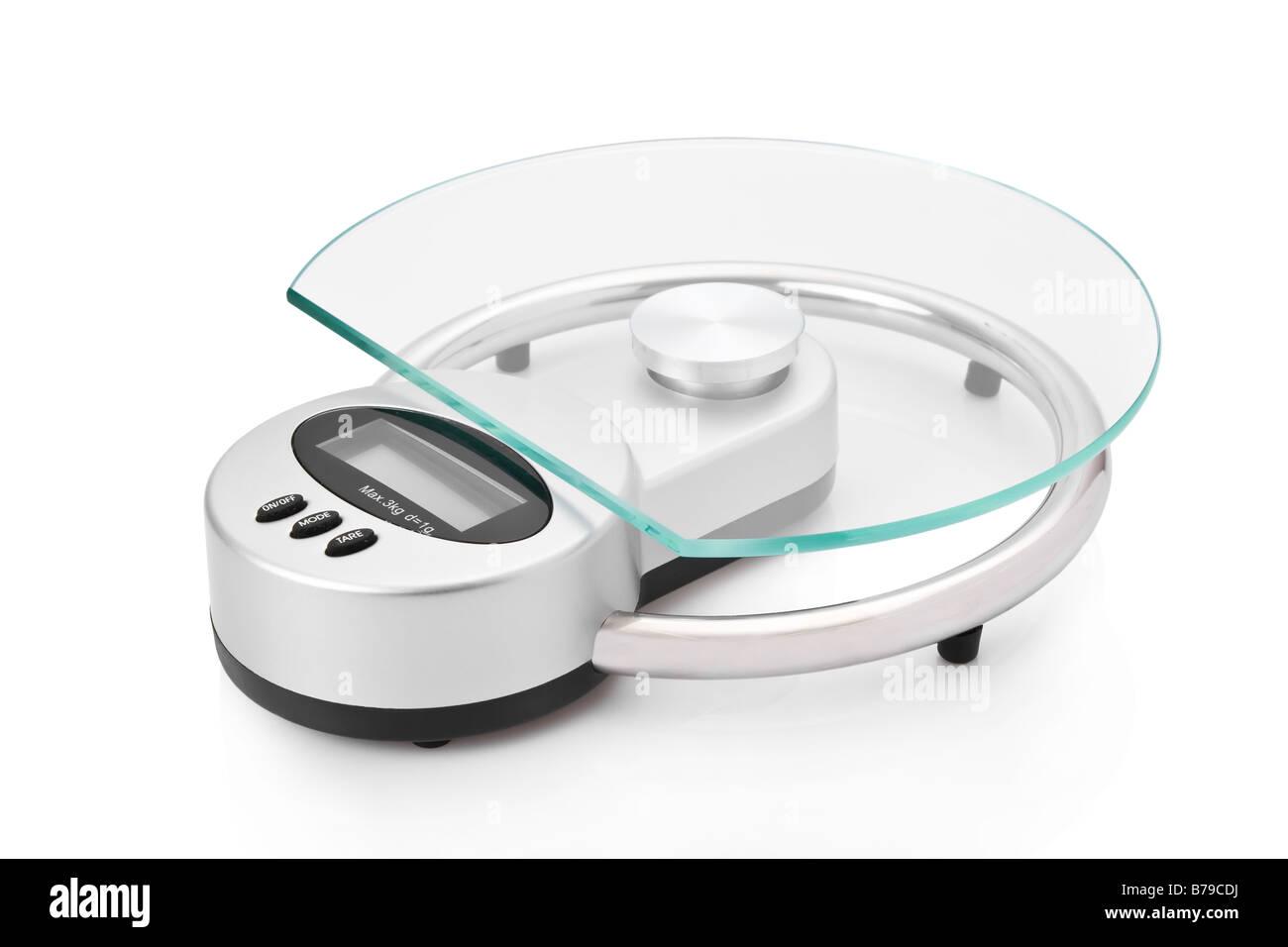 Modern digital kitchen scale isolated on white background - Stock Image