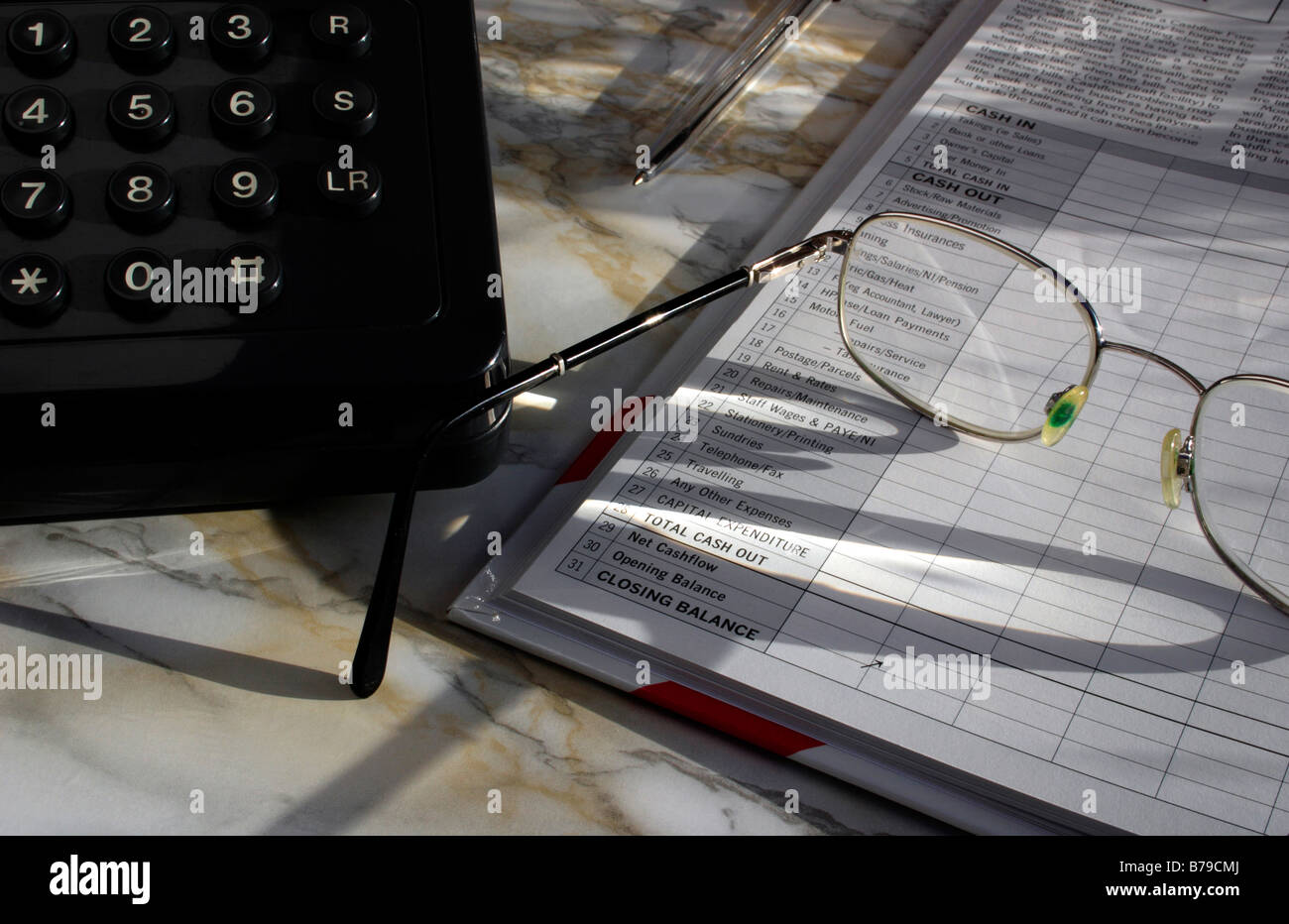 A group of items relating to small business accounting and record keeping. - Stock Image
