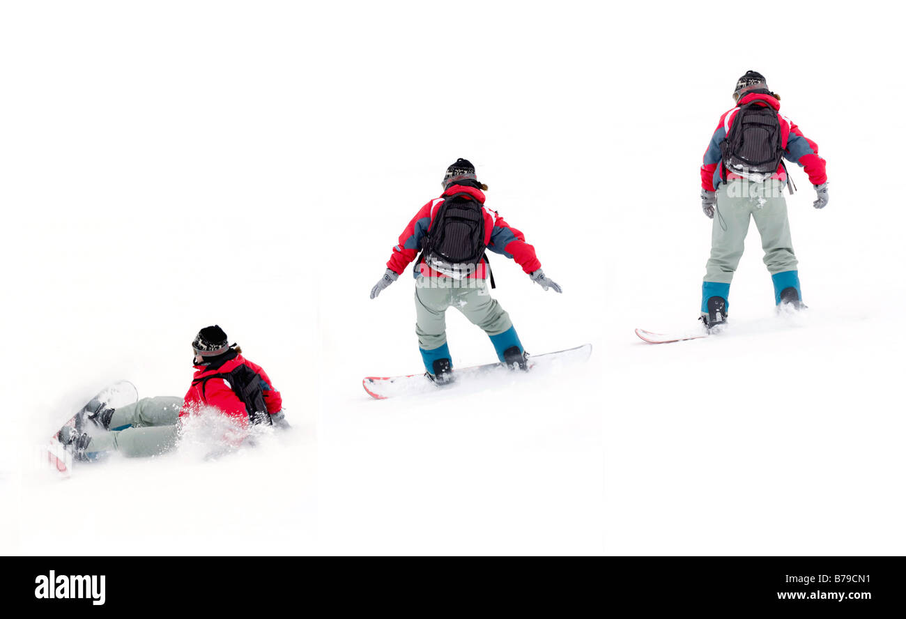 girl snowboarder falling on the snow - Stock Image
