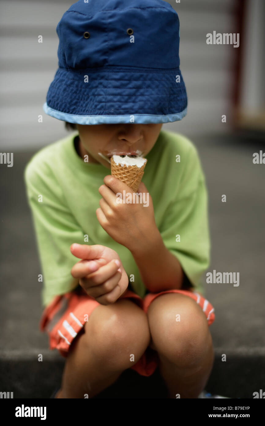 Six year old boy eating ice cream - Stock Image