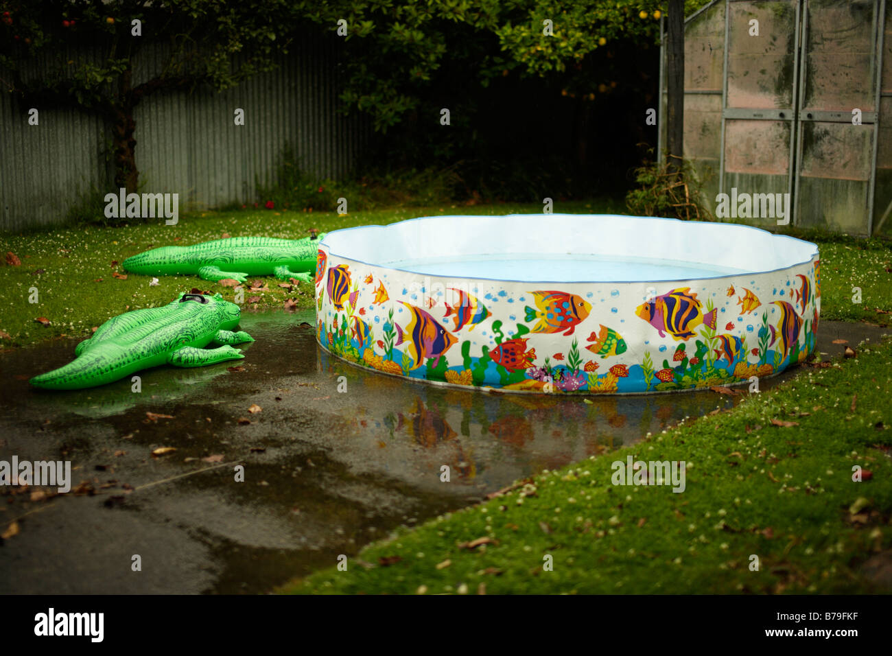 Paddling pool in the rain - Stock Image