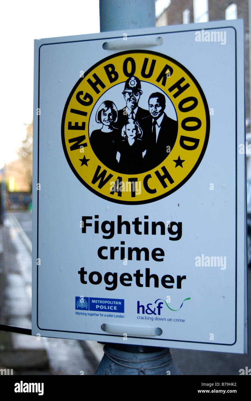 metropolitan police neighbourhood watch sign on a street in the london borough of hammersmith and fulham, england - Stock Image