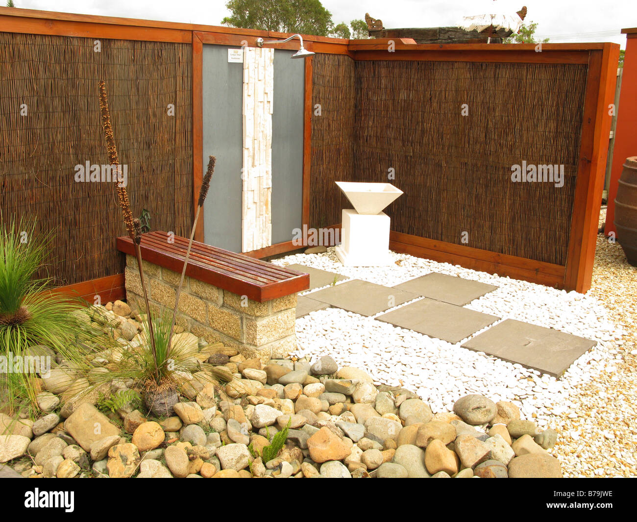 An outdoor shower set in Asian style garden landscape - Stock Image