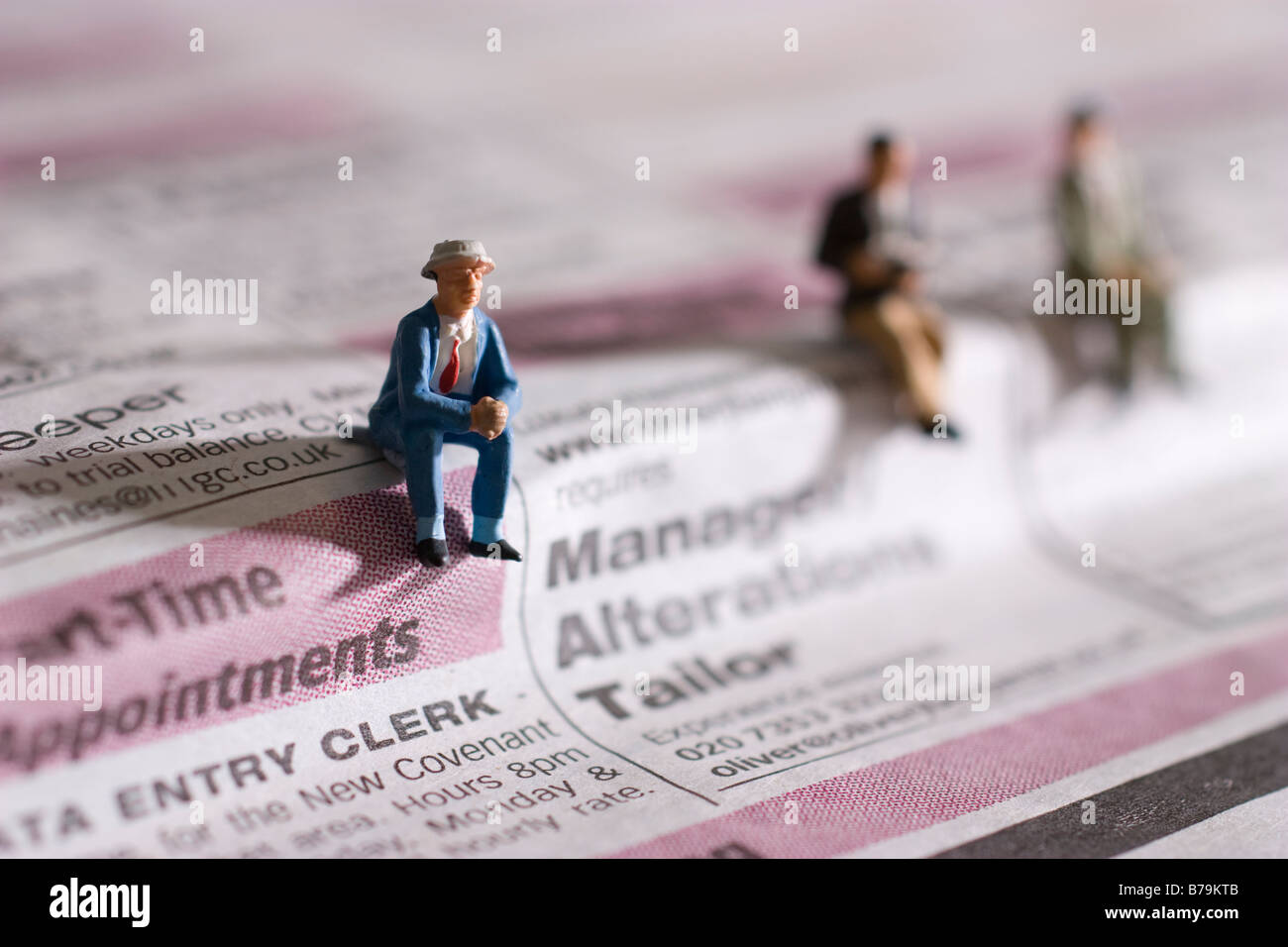 models of workers on situation vacant column of newspaper - Stock Image
