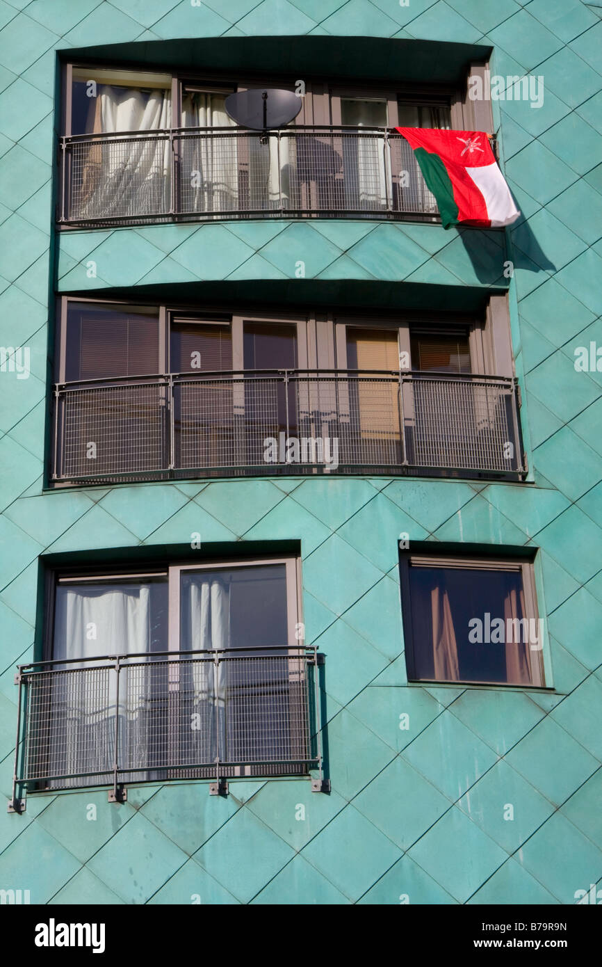 Palestine flag hanging out of an apartment in support of the anti Israel war against Gaza rally, in Albert Square, - Stock Image