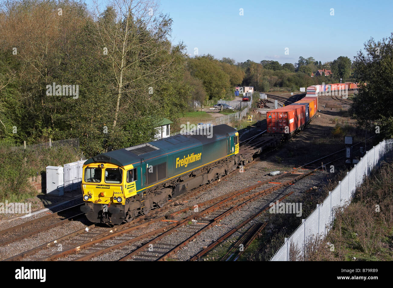 66577 heads Freightliners 4M86 03 04 Felixstowe Lawley Street intermodal through Whitacre Junction - Stock Image