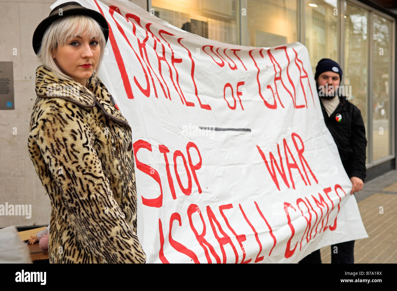Protesters against the Israeli attacks on Gaza holding sign in Bristol UK 18 January 2009 - Stock Image