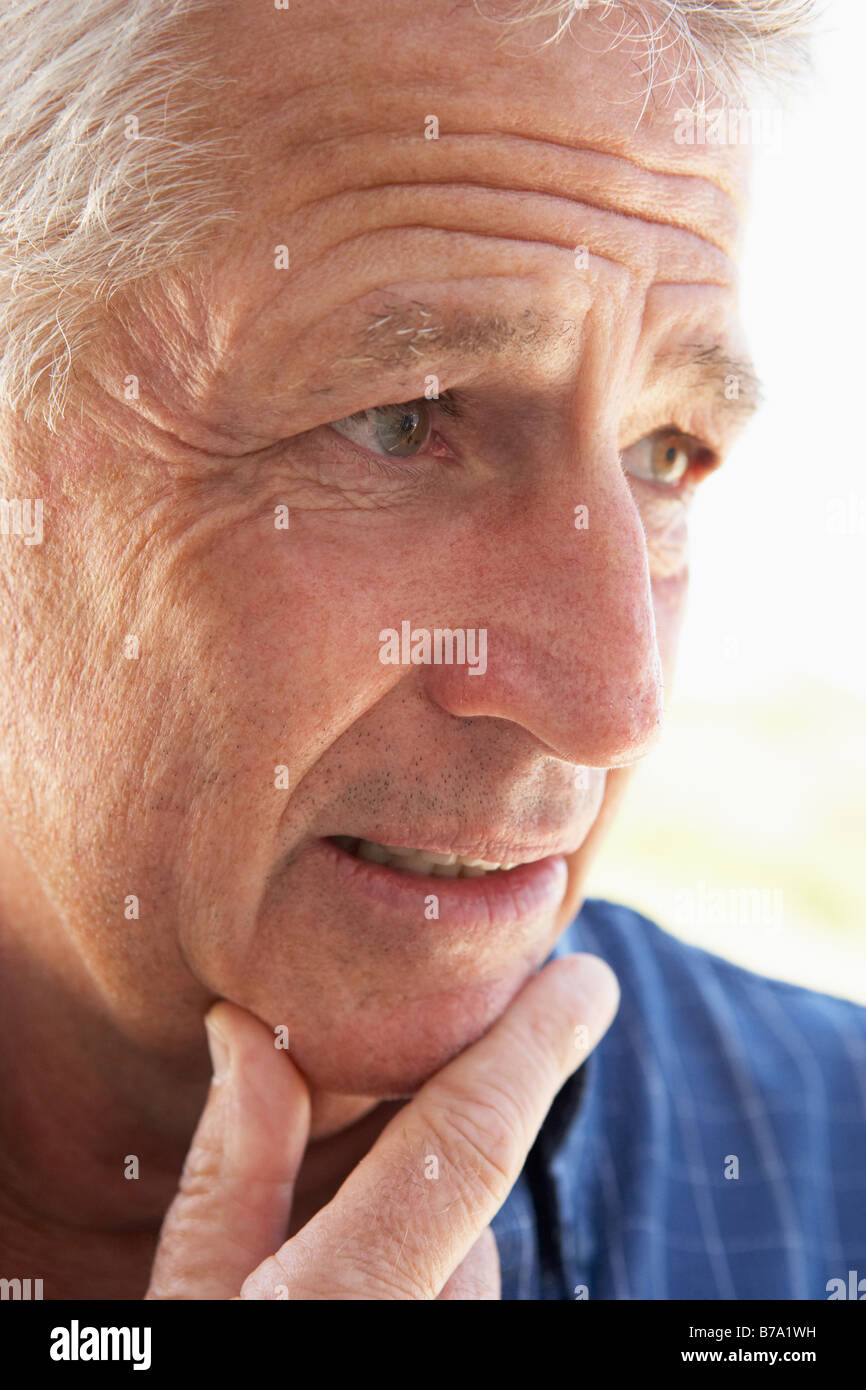 Portrait Of Middle Aged Man Looking Worried - Stock Image