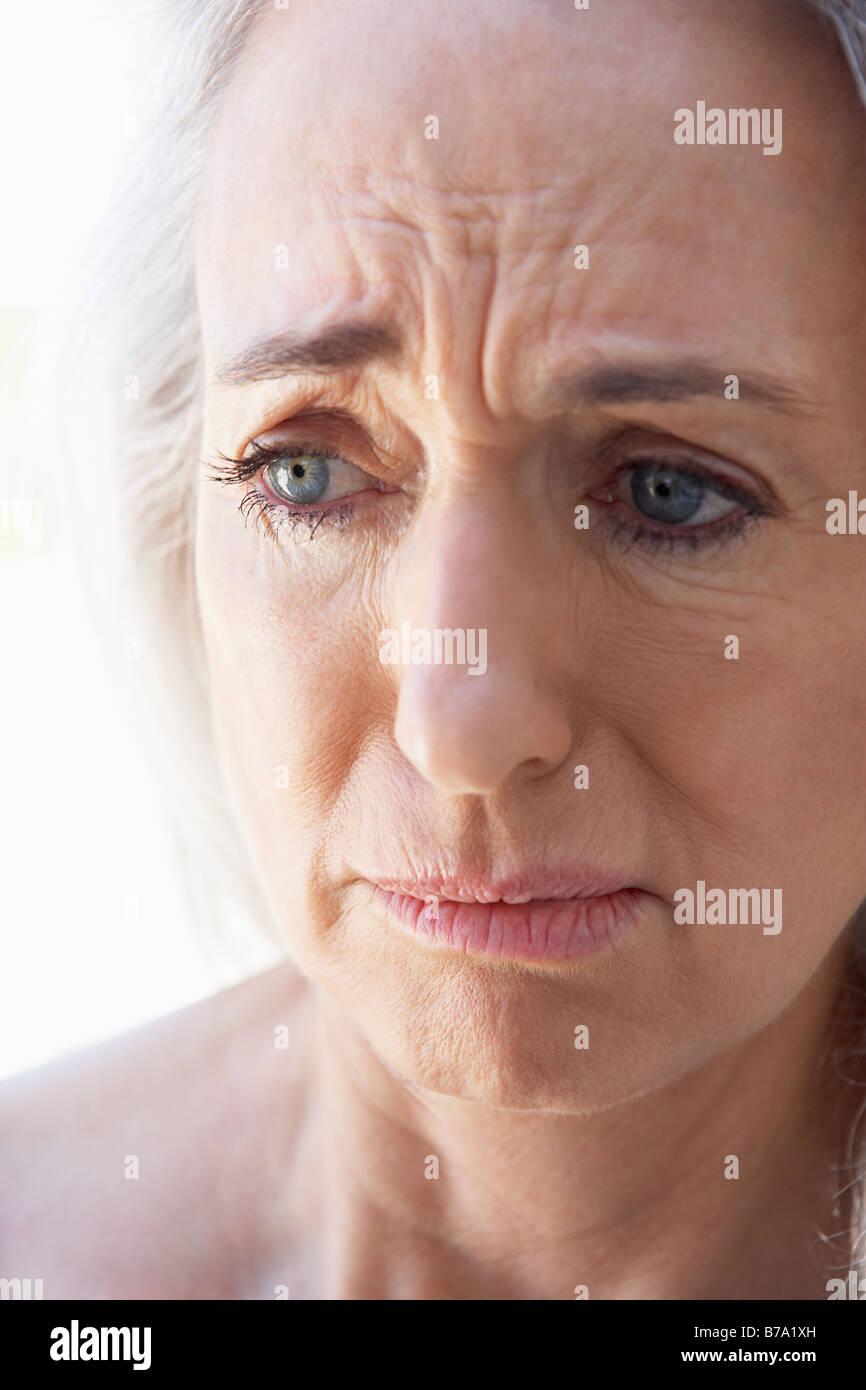 Portrait Of Senior Woman Looking Anxious Stock Photo