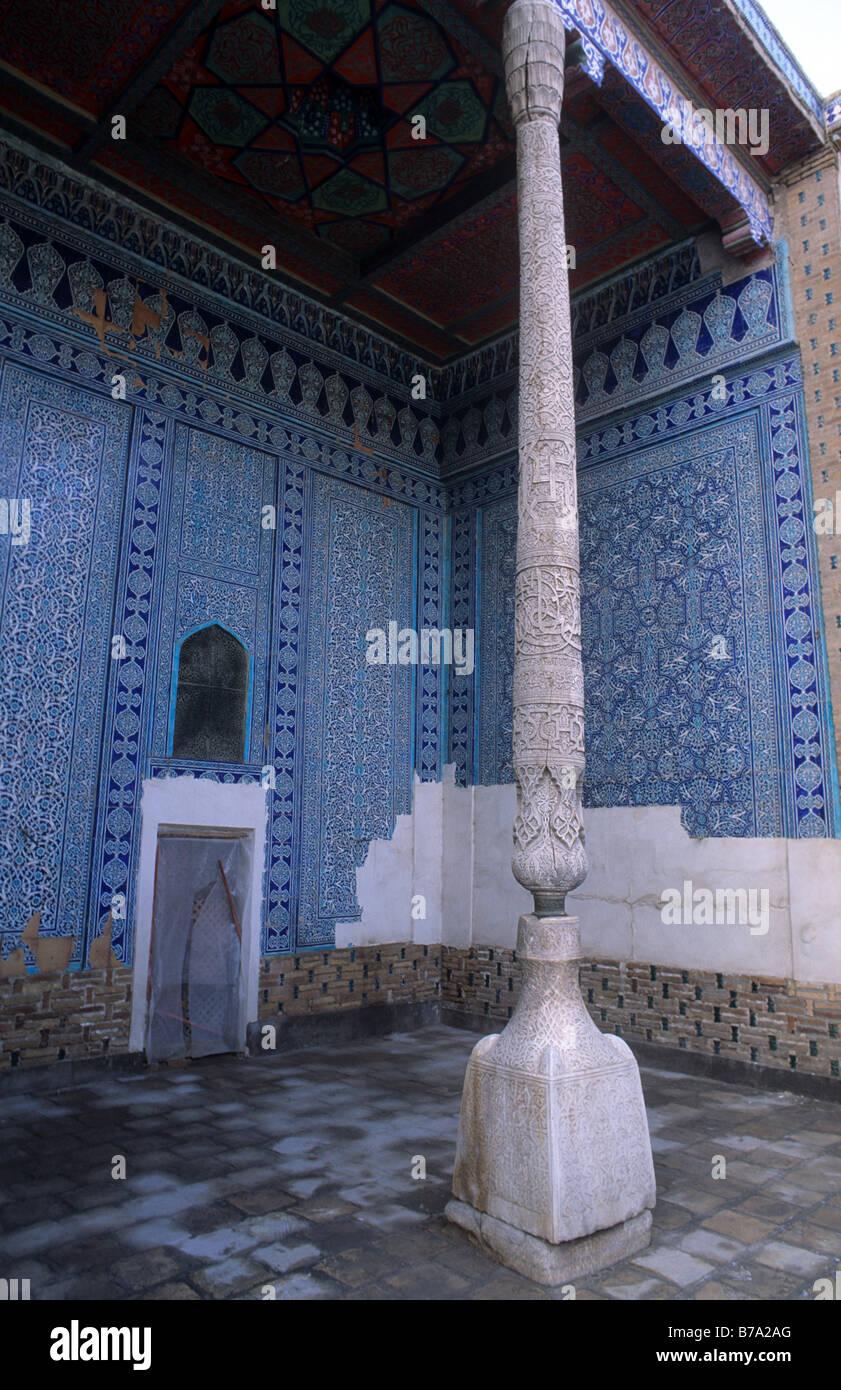 Carved wooden column on carved stone base Harem Tash Khauli Huali Palace Stone Palace or Stone Yard Khiva Uzbekistan - Stock Image