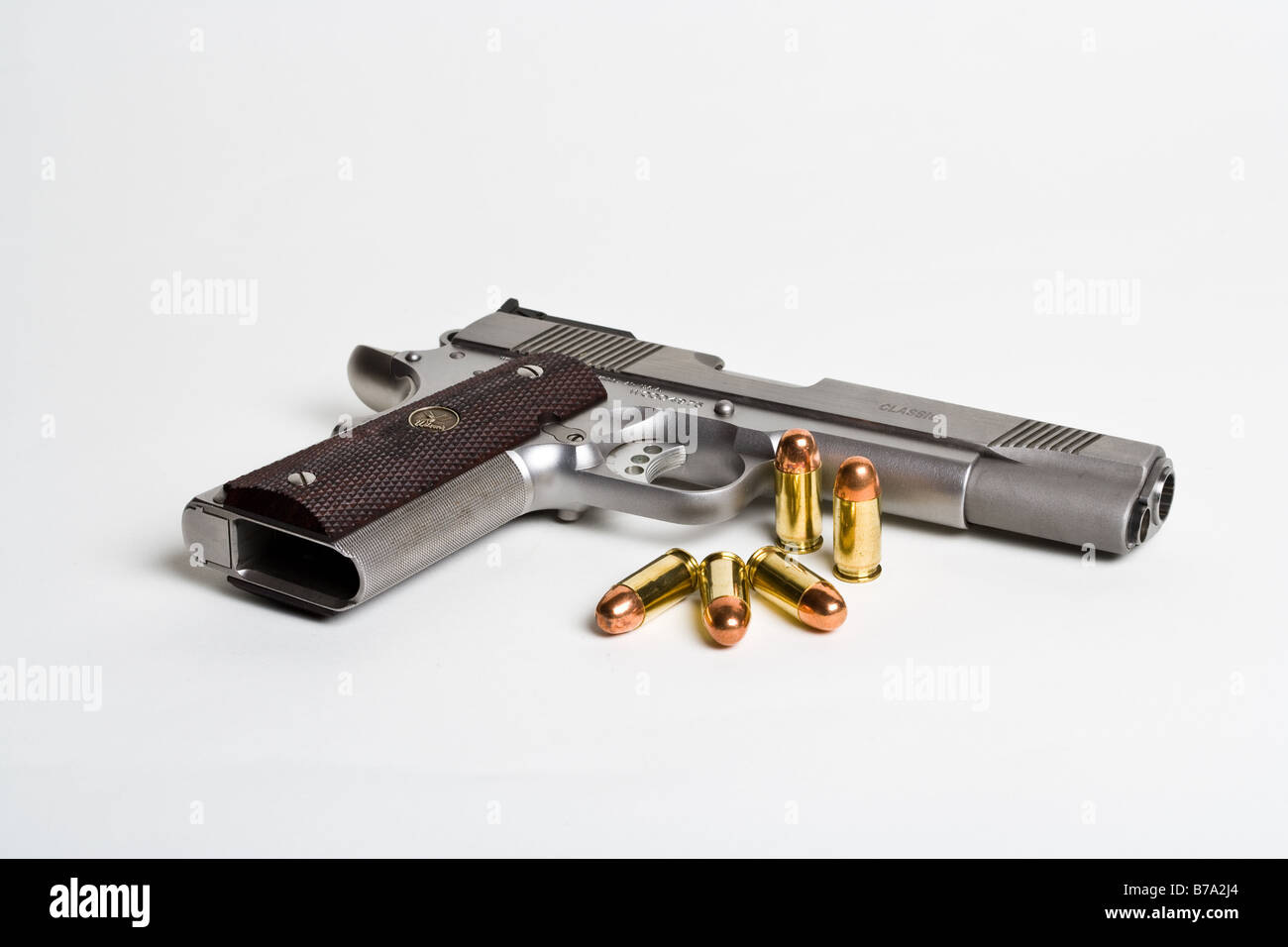 A .45 Auto 1911 style pistol and ammunition - Stock Image