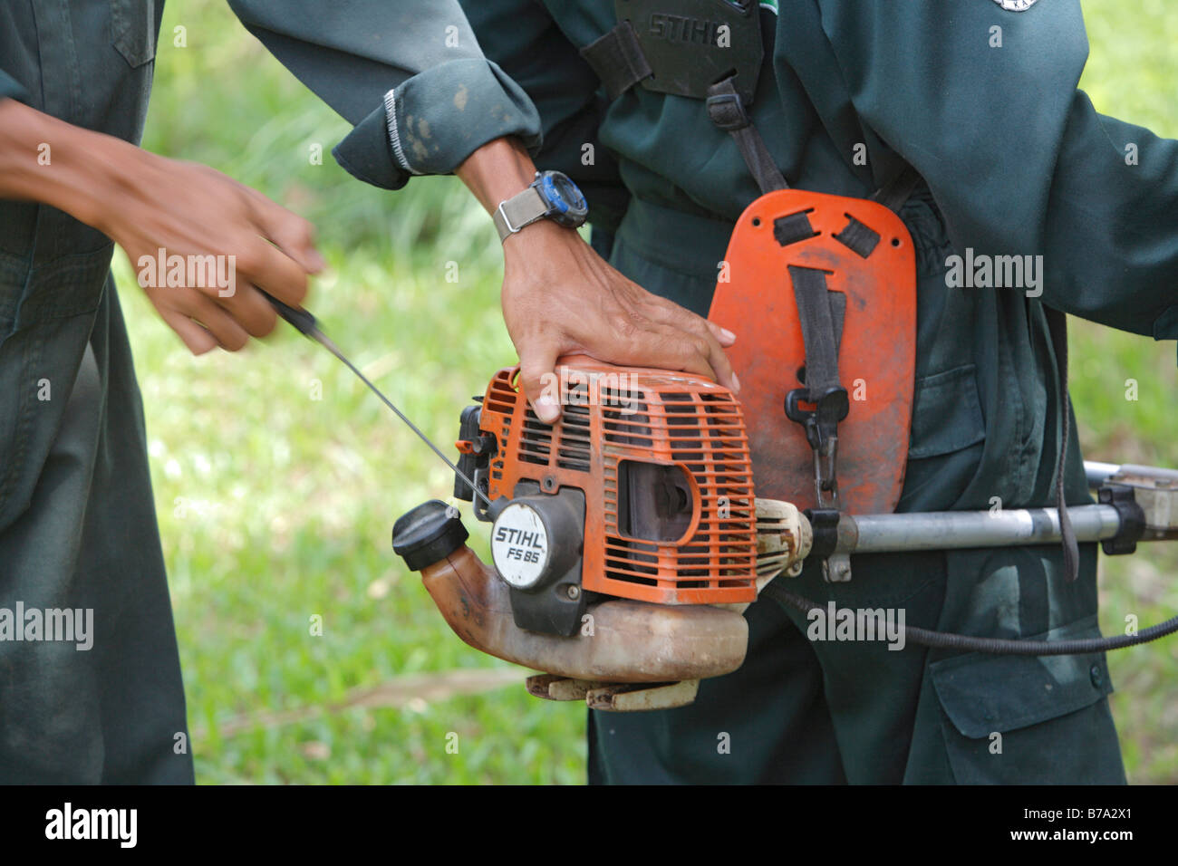 Starting a string trimmer or line trimmer - Stock Image