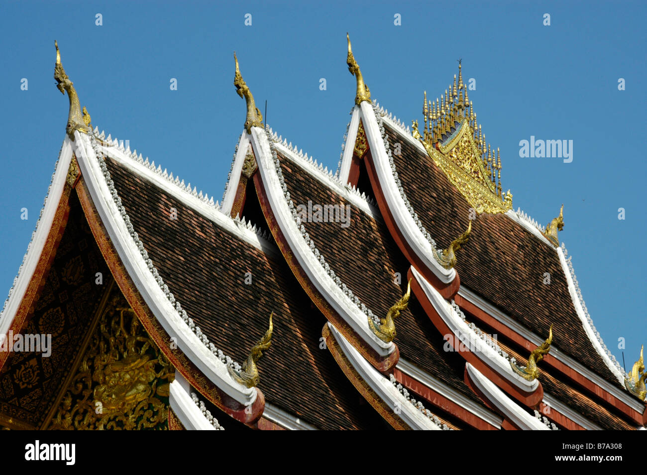 Segmented roof of the Haw Pha Bang Buddhist tempel inside the Royal Palace compound, Luang, Laos, Southeast Asia Stock Photo