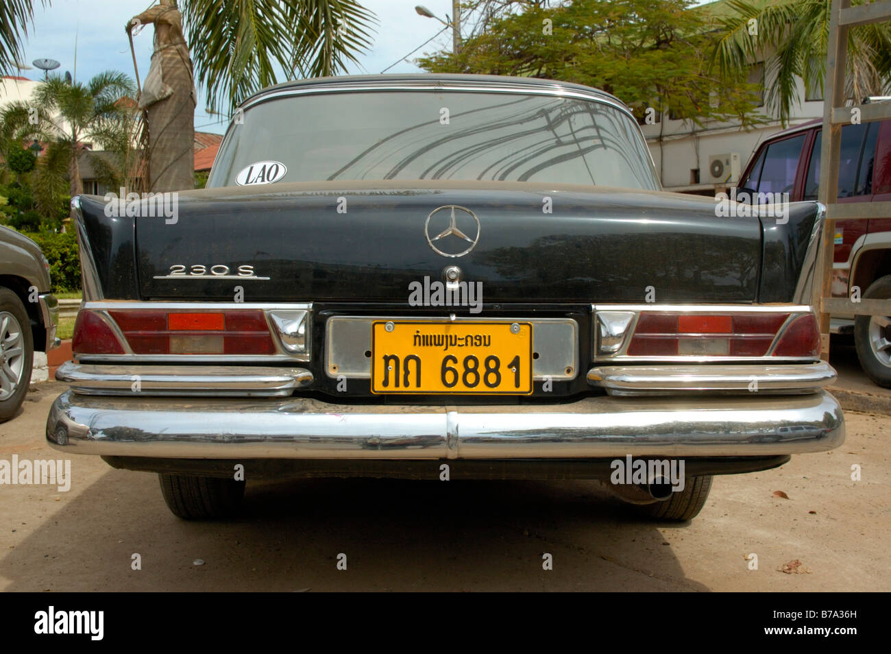 Vintage car, old black Mercedes 230S with a Laotian number plate ...