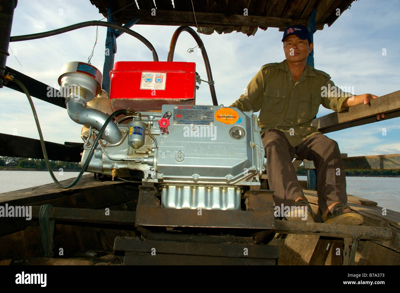 Ferryman in his boat with a new Chinese engine, Stung Treng, Cambodia, Southeast Asia Stock Photo