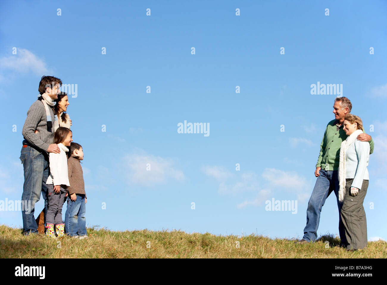 Family Standing In The Park - Stock Image