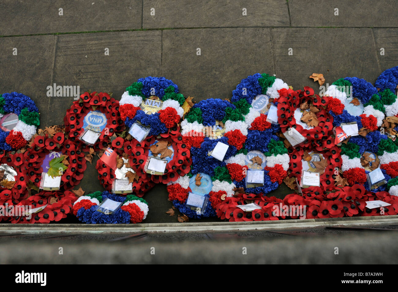 Close up of Poppy wreaths at trinity square during a Remembrance Service - Stock Image