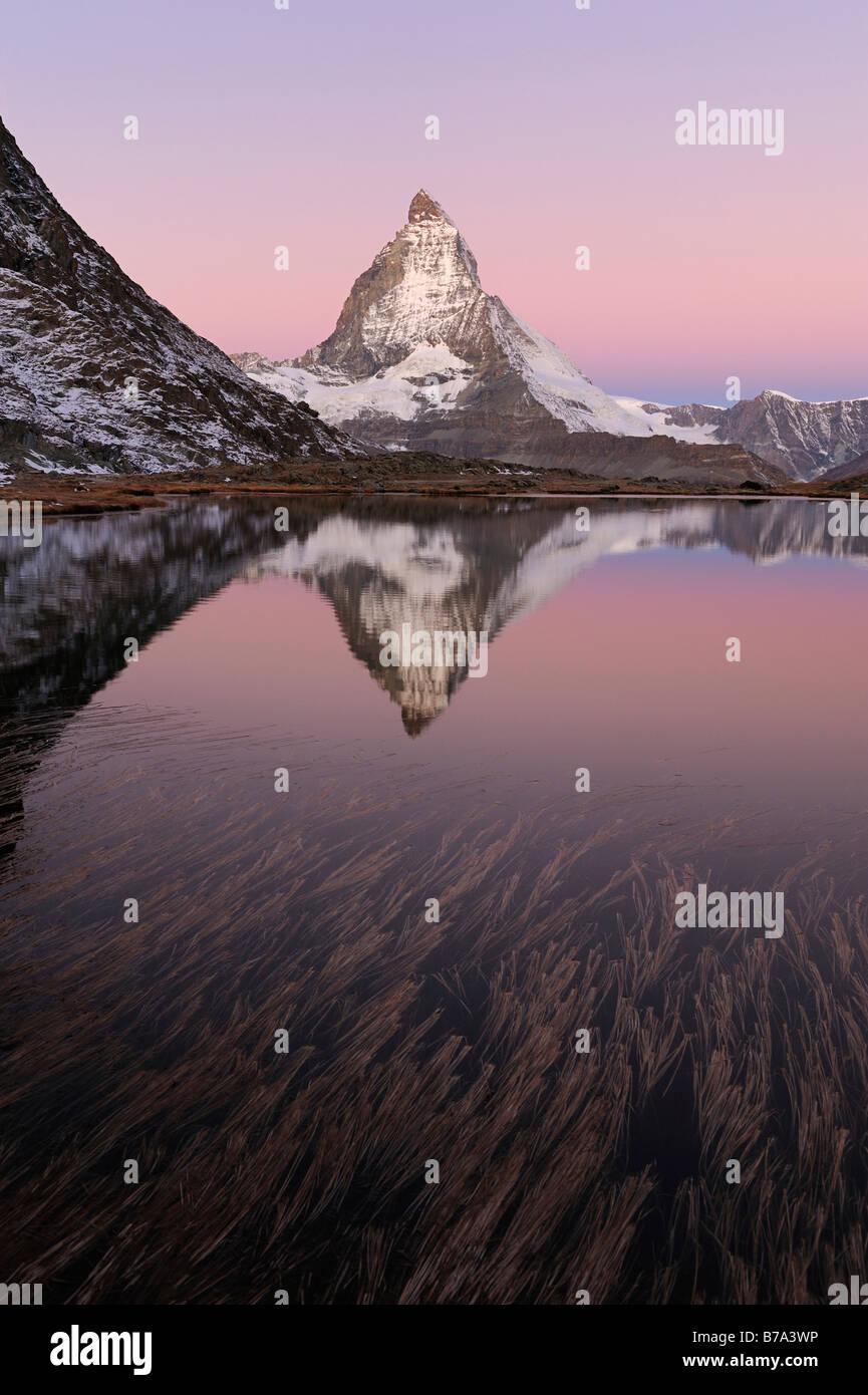 Matterhorn reflection in Riffelsee, Zermatt, Wallis, Switzerland, Europe - Stock Image