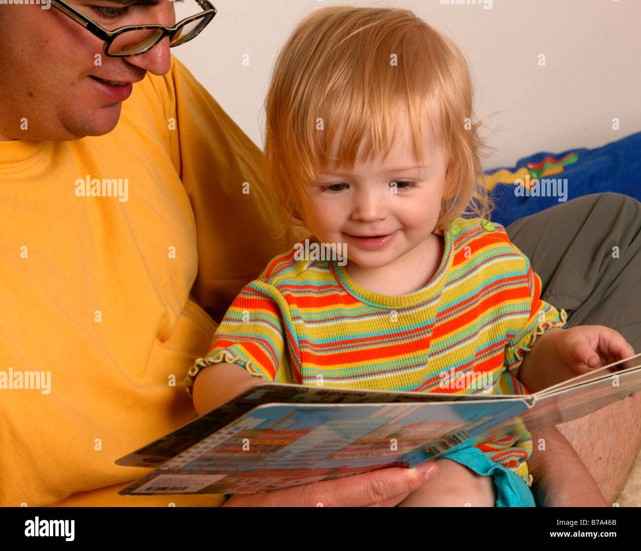 Father reading to his child Stock Photo