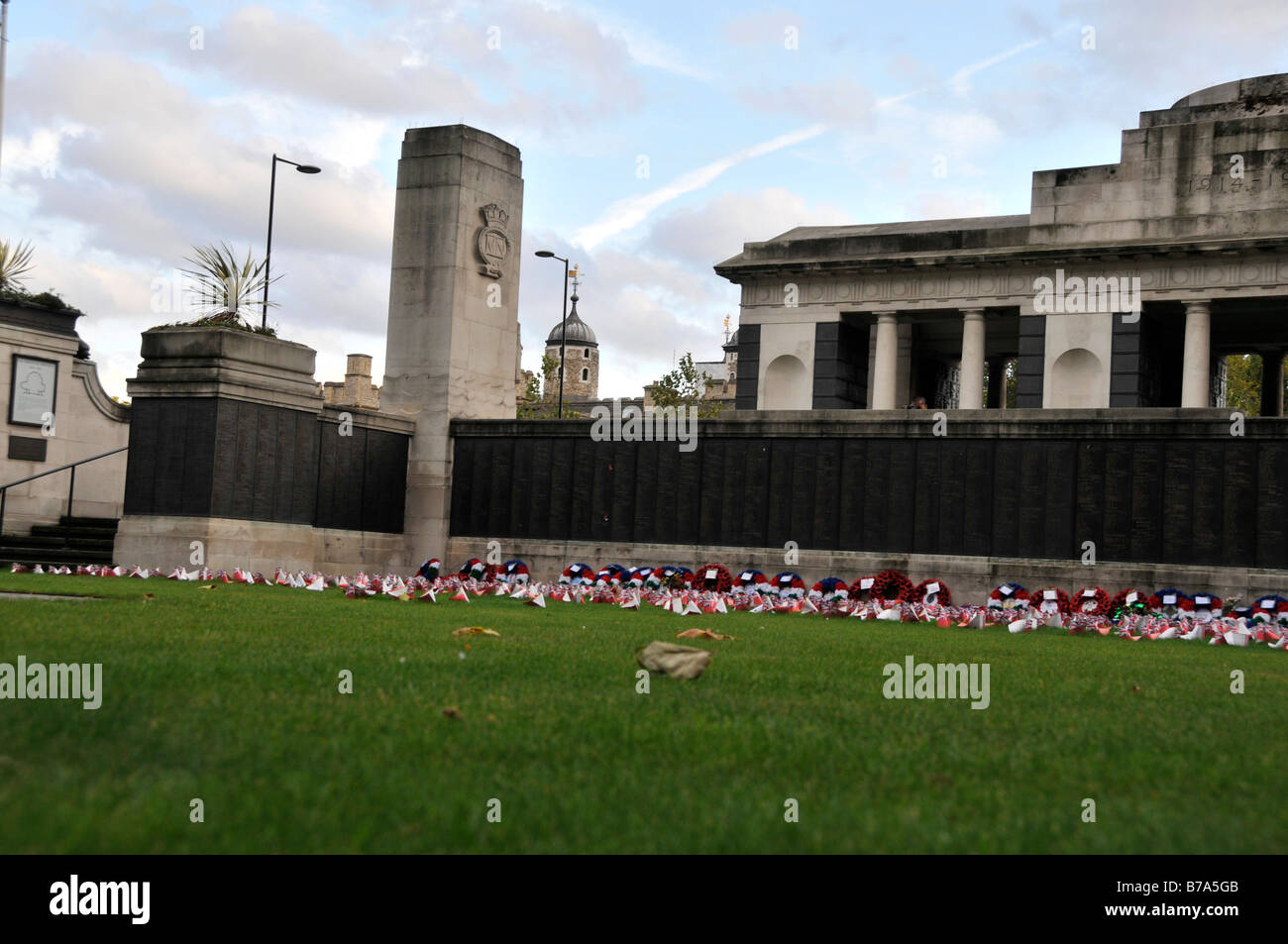 British flags and poppy wreaths at trinity square during a Remembrance Service - Stock Image