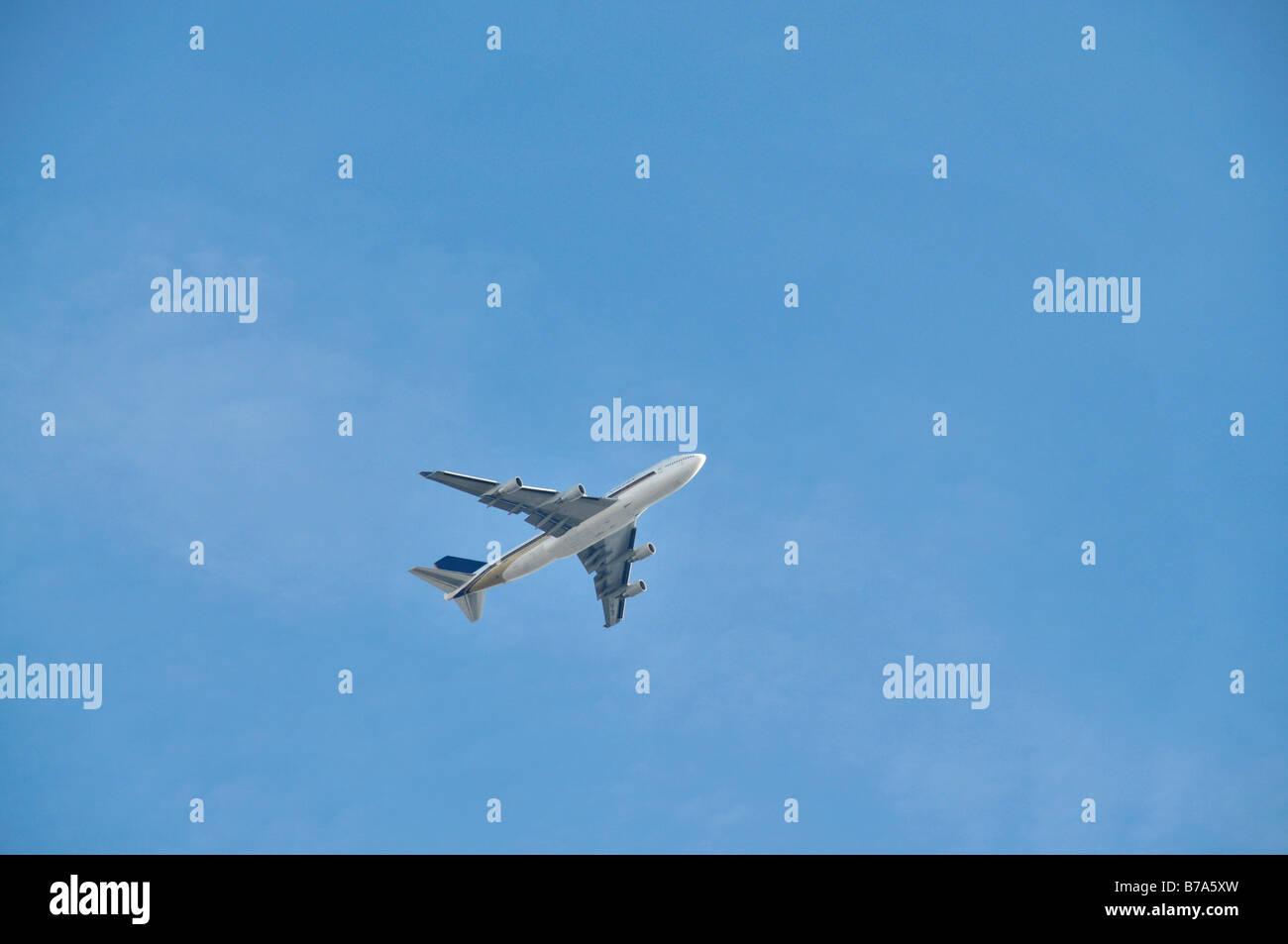 Plane on blue sky - Stock Image